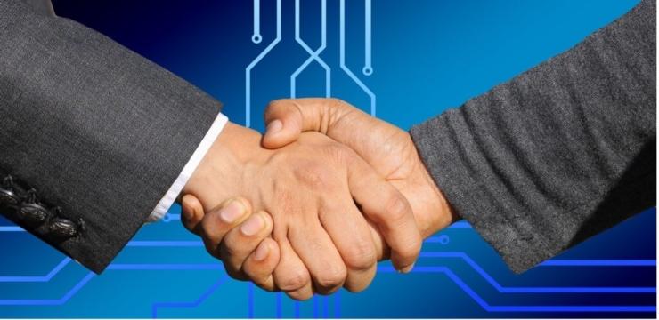 shaking hands deal business businessmen businesswomen